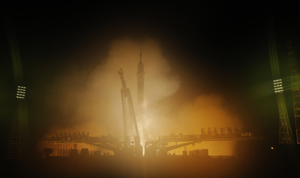 The Soyuz-FG rocket booster with Soyuz TMA-12M space ship carrying a new crew to the International Space Station (ISS) blasts off at the Russian leased Baikonur cosmodrome, Kazakhstan, Wednesday, March 26, 2014.