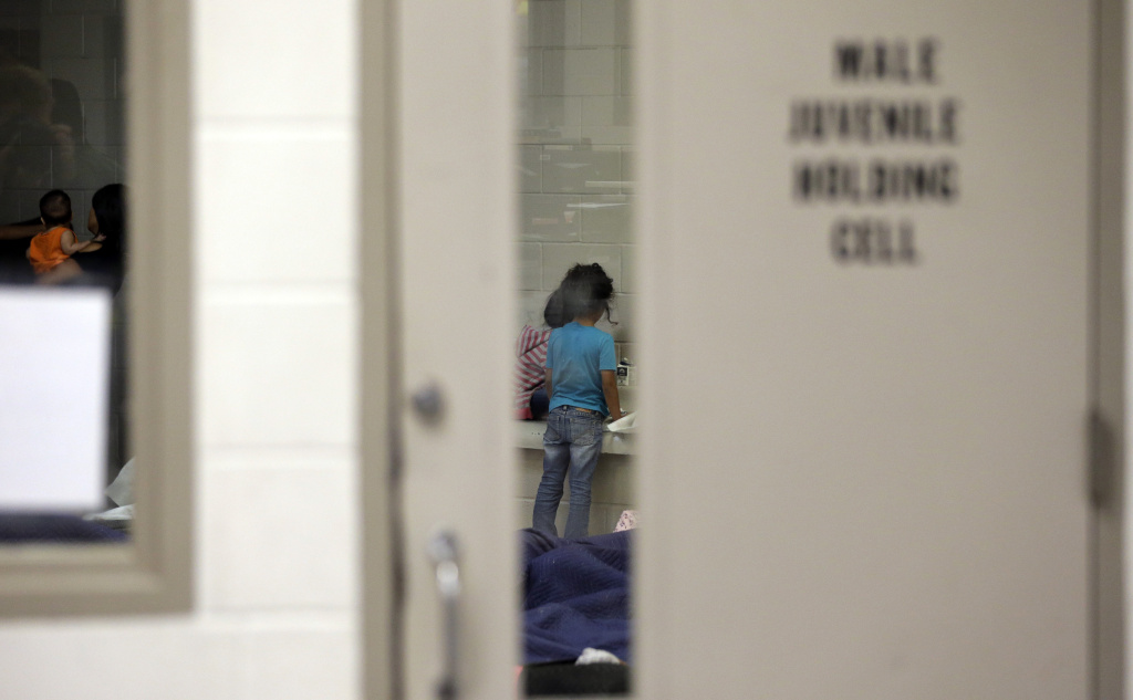 Detainees wain in a holding cell at a U.S. Customs and Border Protection processing facility, on June 18, 2014, in Brownsville,Texas.