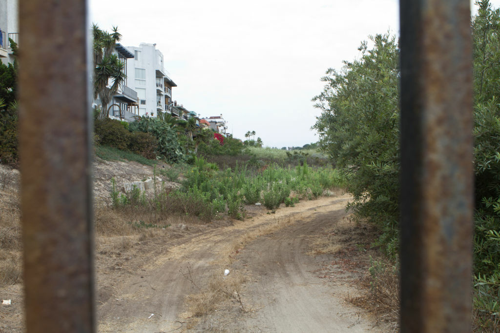 A pathway near the locked entrance to the Ballona Wetlands on Vista Del Mar.