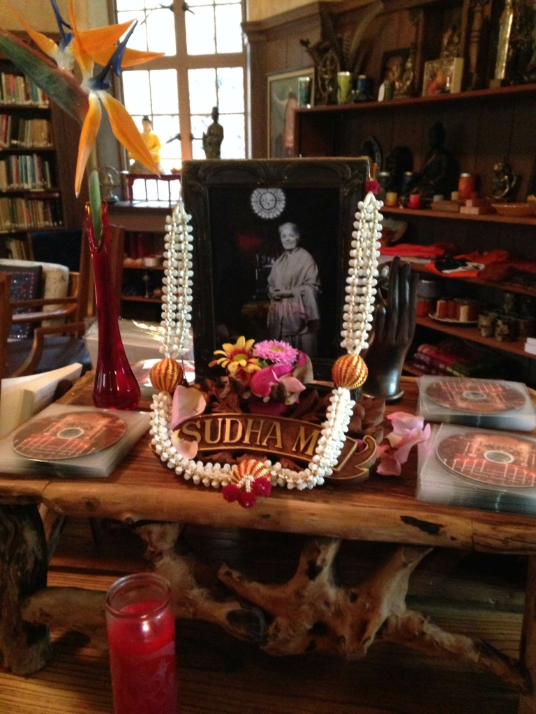 Flowers adorn Sudha Ma's photo in the Ananda Ashrama bookstore, where devotees can purchase recordings of her sermons and copies of her books.