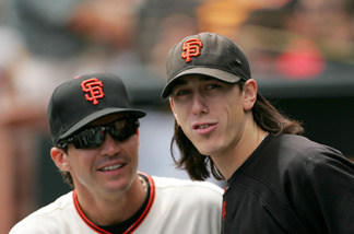 Tim Lincecum #55 and Barry Zito (R) #75 of the San Francisco Giants stands in the dugout before their game against the Colorado Rockies at AT&T Park on August 30, 2009 in San Francisco, California.