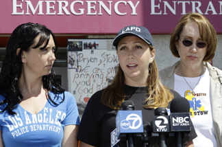 Erin Collins, center, sister, Bonnie Stow, left, sister, and Ann Stow, right, mother of San Francisco Giants fan Bryan Stow, express thanks during a news conference at a hospital in San Francisco, Monday, May 23, 2011. Bryan Stow, 42, was severely beaten outside Dodger Stadium in Los Angeles on March 31, 2011. A tip from a parole officer late last week led to the arrest Sunday of Giovanni Ramirez, 31, of Los Angeles in the attack.