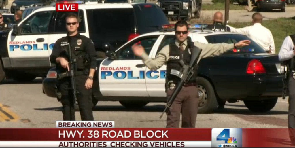 This is a screen shot from NBC LA as police man a road block on state Route 38 in the Big Bear area on Feb. 12, 2013. Police engaged in a gun battle with a man they believe is Christopher Dorner, wanted for murder and attempted murder.