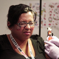 "In this video still from KPCC's ""Living Hello Kitty"" video, superfans get free permanent Hello Kitty tattoos on Thursday, Oct. 30, 2014 during Hello Kitty Con at the Museum of Contemporary Art, Los Angeles."
