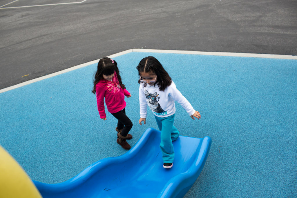 Vanessa Delgado and Ashley Vargas play during recess at Martha Escutia Primary Center, which offers transitional kindergarten.