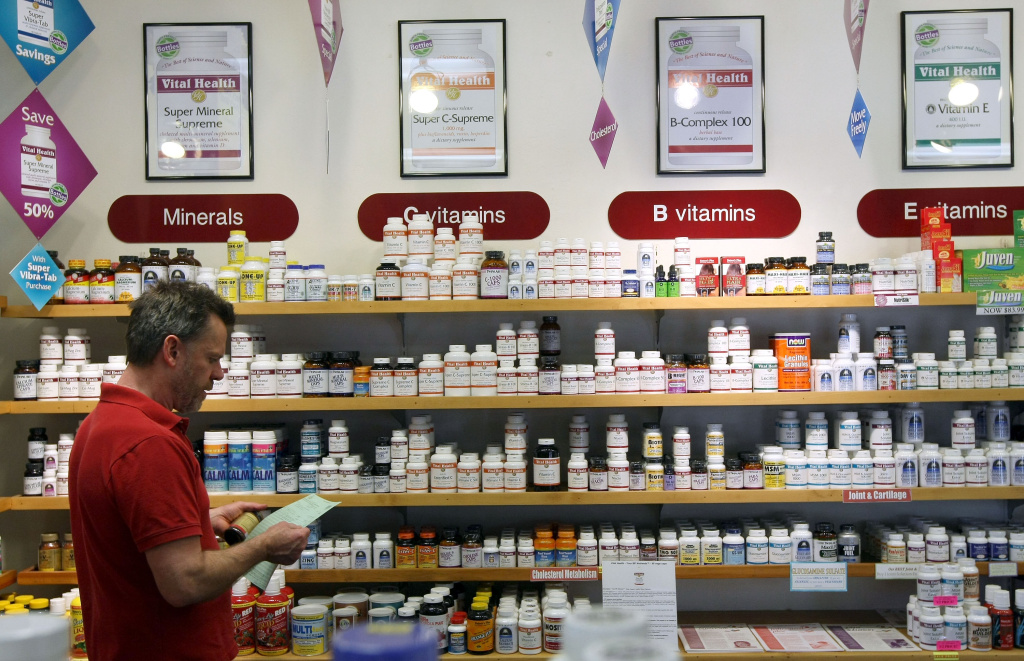 Don Olufs checks inventory of vitamins and diet supplements at Vibrant Health April 6, 2009 in San Francisco, California.