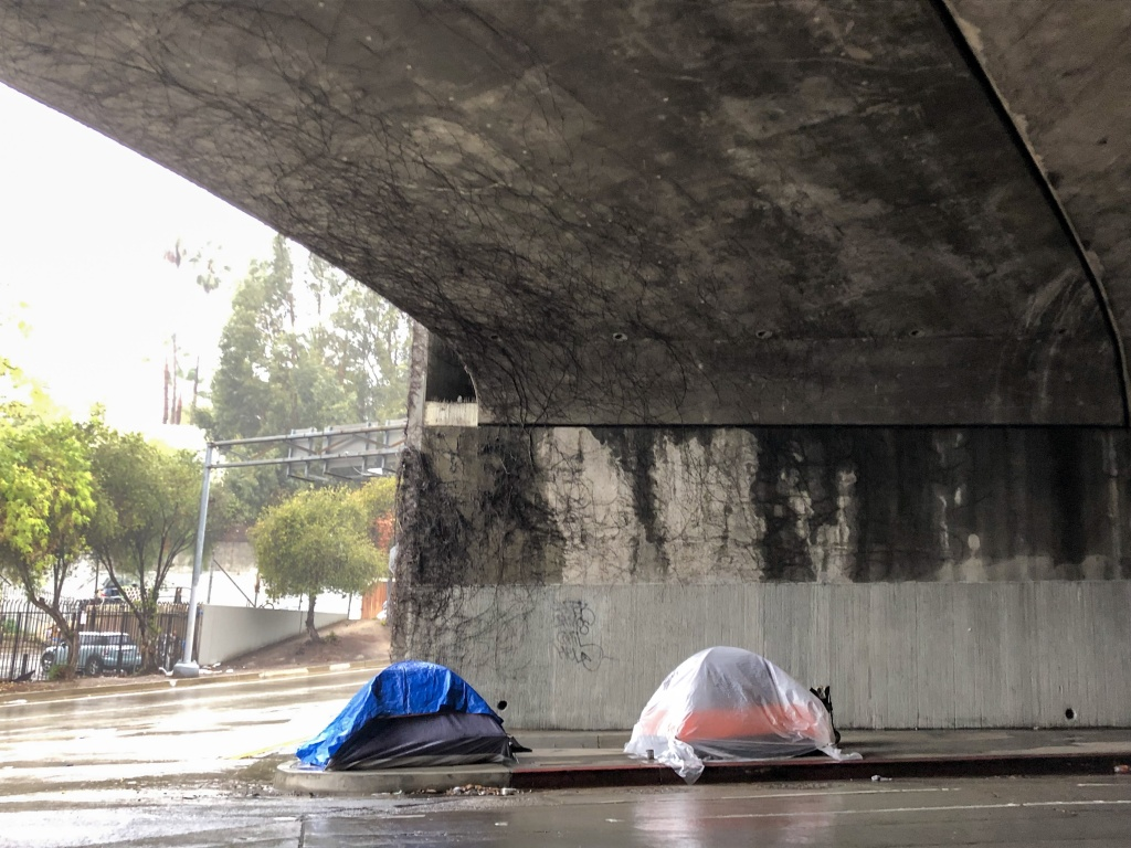 Two tents in Hollywood erected beneath the 101 Freeway during a January rainstorm. (Matt Tinoco/KPCC)