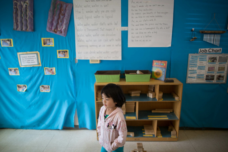 An instructor reads to children at University Village, one of three pre-schools run by UCLA Early Care and Education.