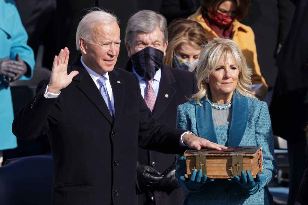 WASHINGTON, DC - JANUARY 20: Joe Biden is sworn in as U.S. President as his wife Dr. Jill Biden looks on during his inauguration on the West Front of the U.S. Capitol on January 20, 2021 in Washington, DC.  During today's inauguration ceremony Joe Biden becomes the 46th president of the United States. (Photo by Alex Wong/Getty Images)