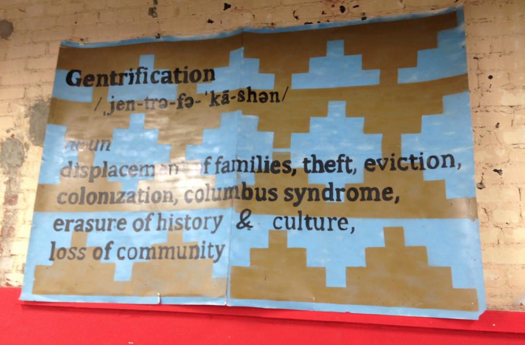 A piece by the local art collective Ni Santas is displayed inside Self Help Graphics & Art in Boyle Heights.