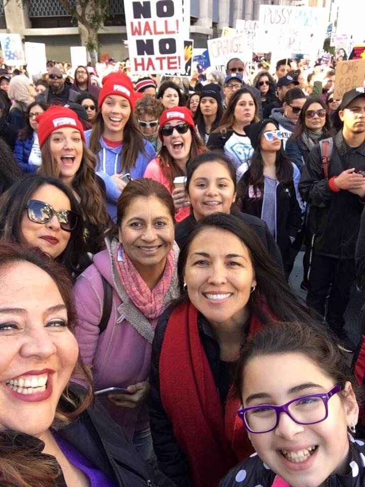 Nubia Cedeño, with sunglasses, along with other marchers in downtown Los Angeles last Saturday. Cedeño said as a parent and member of an immigrant family, she was motivated to march to advocate for education and immigrant rights.