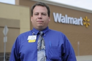 Walmart employee James Buskell expects to graduate with a degree in retail management in 2012.