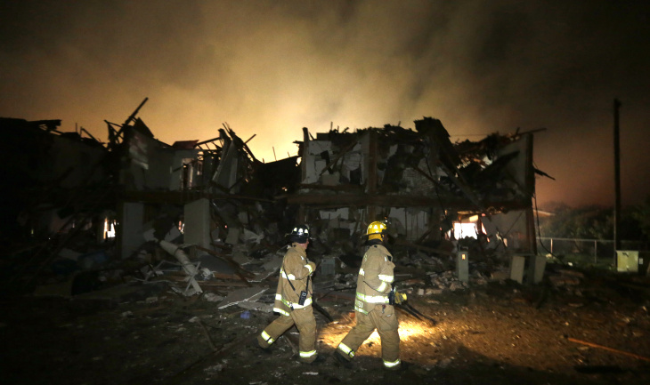 Firefighters check a destroyed apartment complex near the fertilizer plant that exploded earlier in West, Texas, in this photo made early Thursday, April 18, 2013.