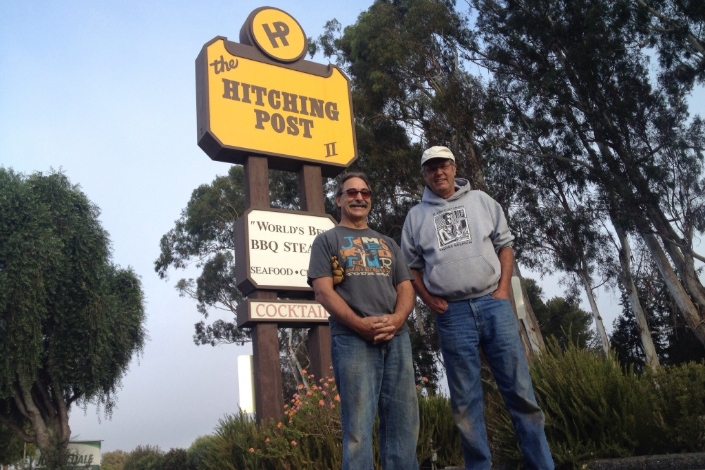 Hitching Post partners Frank Ostini and Gray Hartley pose in the spot where thousands of tourists have snapped pictures since