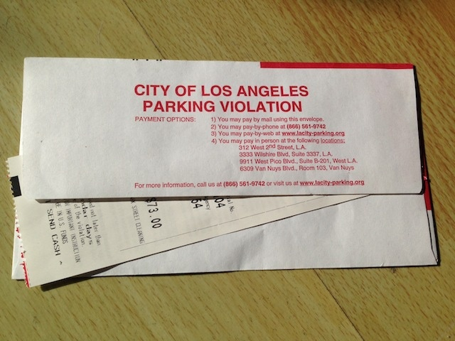 Fewer parking citations have issued so far this year. (Photo by Jean Trinh/LAist)