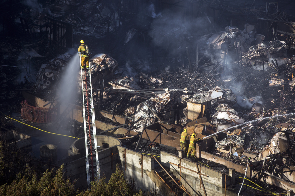 An early-morning fire consumed a seven-story apartment complex that was still under construction in downtown Los Angeles on Monday, Dec. 8, 2014.