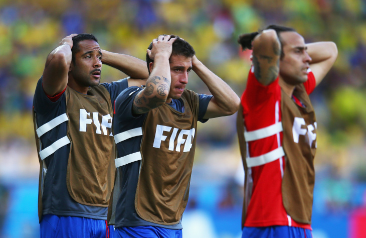 (L to R) Jean Beausejour, Carlos Carmona and Jorge Valdivia of Chile looks on in front of the bench during the 2014 FIFA World Cup Brazil Round of 16 match between Brazil and Chile at Estadio Mineirao on June 28, 2014 in Belo Horizonte, Brazil.