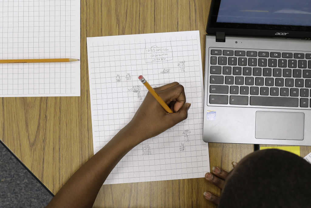 In this Feb. 12, 2015 file photo, Yamarko Brown, age 12, works on math problems as part of a trial run of a new state assessment test — linked to the Common Core standards — at Annapolis Middle School in Annapolis, Md. The California Board of Education is expected to decide Wednesday, March 11, 2015, whether or not schools should be held accountable on the state's own performance index for student results in the new Common Core-aligned assessments.