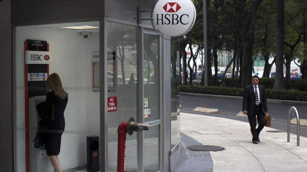 A woman uses a cash machine at an HSBC bank office in Mexico City. The multi-national bank was heavily penalized several years ago for permitting huge transfers of drug cartel money between Mexico and the U.S.