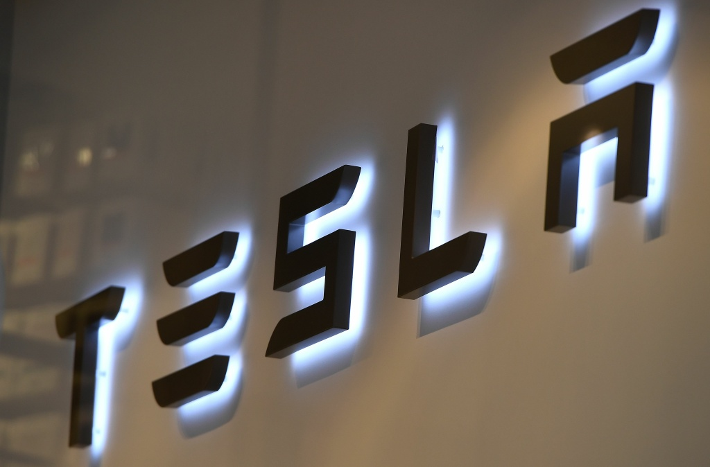 This photo shows the logo if US car maker Tesla in Brussels on February 8, 2018.