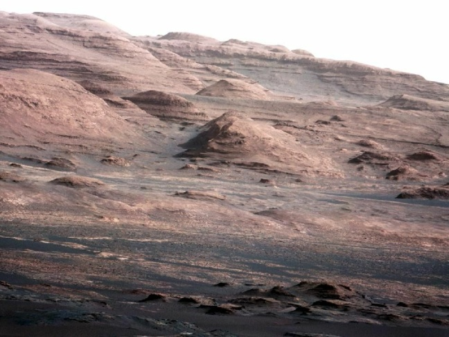 This image taken by the Mast Camera (MastCam) on NASA's Curiosity rover highlights the interesting geology of Mount Sharp, a mountain inside Gale Crater, where the rover landed.