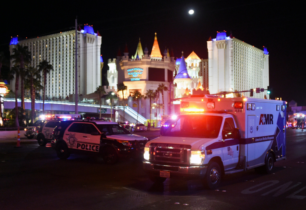 An ambulance leaves the intersection of Las Vegas Boulevard and Tropicana Ave. after the mass shooting at the Route 91 Harvest Country Music Festival on Oct. 2, 2017.