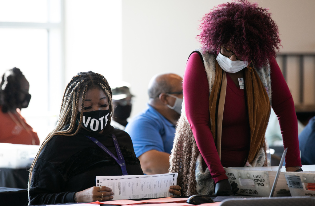Fulton County workers count absentee ballots on Nov. 6, 2020, in Atlanta. A judge's order marks the latest challenge for the county in a seemingly never-ending election cycle.