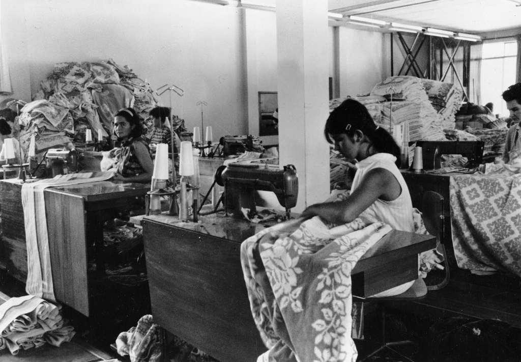 Women working at sewing machines in the 1970s.