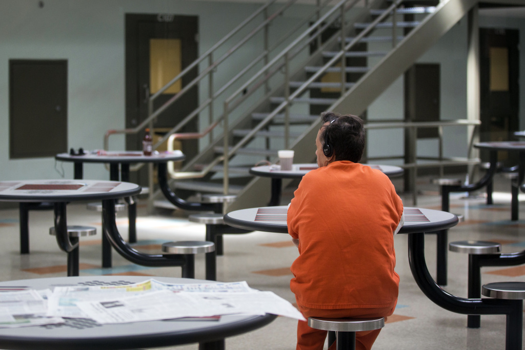 Standard housing dorms at the U.S. Immigration and Customs Enforcement's Detention Facility in Adelanto each have a common area with tables.