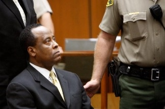 Dr. Conrad Murray sits near the bailiff as he appears at Los Angeles Superior Court on April 5, 2010 in Los Angeles, California.