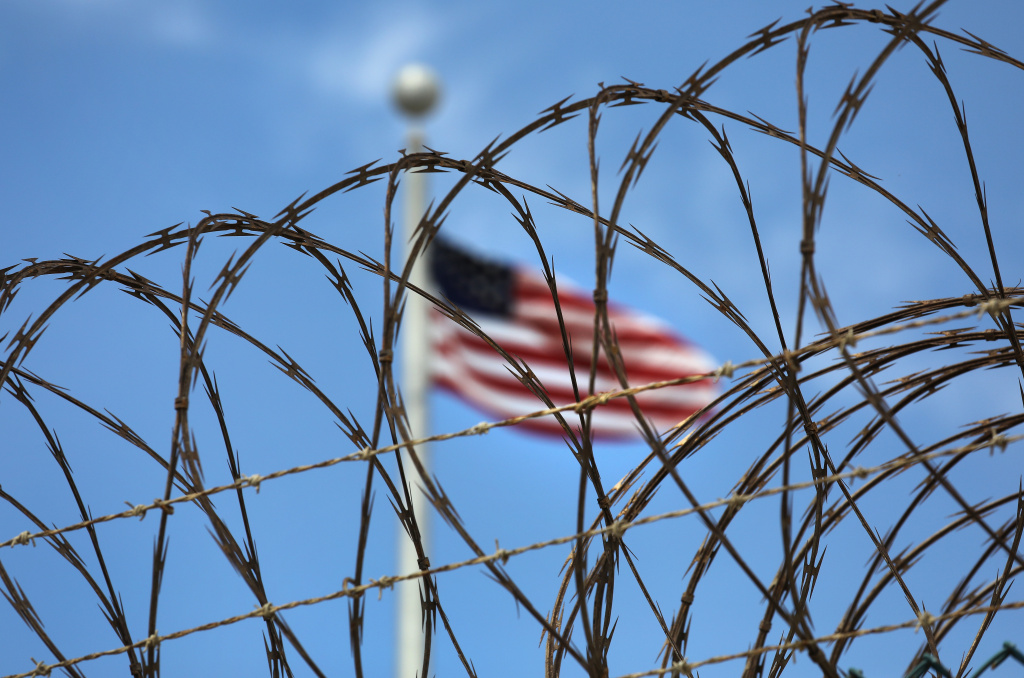 Razor wire tops the fence of the U.S. prison at Guantanamo Bay, also known as