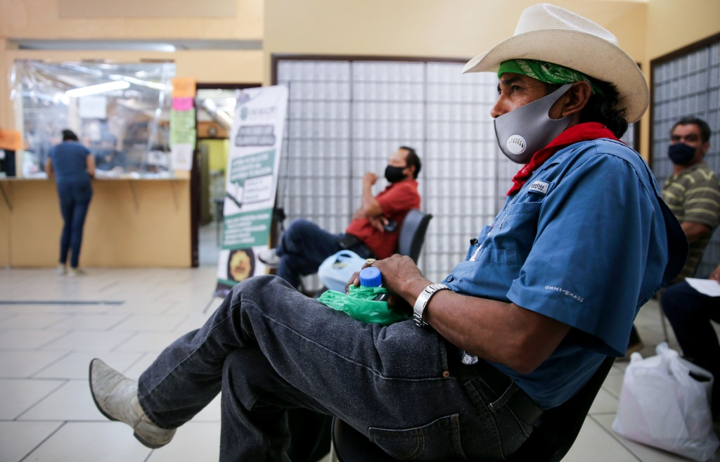 Faustino, who is currently unemployed, waits after filling out unemployment forms in a bookkeeping shop near the U.S.-Mexico border in Imperial County, which has been hard-hit by the COVID-19 pandemic, on July 24, 2020 in Calexico, California.