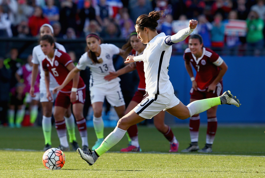 Carli Lloyd, USA, scores with a penalty kick and against Cecilia Santiago of Mexico in the second half during the United States v Mexico: Group A - 2016 CONCACAF Women's Olympic Qualifying at Toyota Stadium on February 13, 2016 in Frisco, Texas.