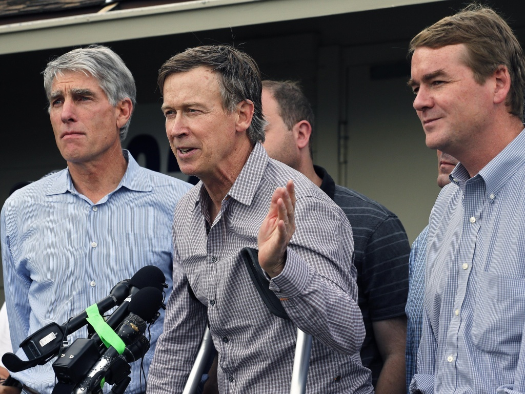 Sens. Mark Udall (left) and Michael Bennet (right) are less likely than other Democratic candidates to benefit from Obama's decision to postpone executive action. Here they're pictured with Colorado Gov. John Hickenlooper (center).