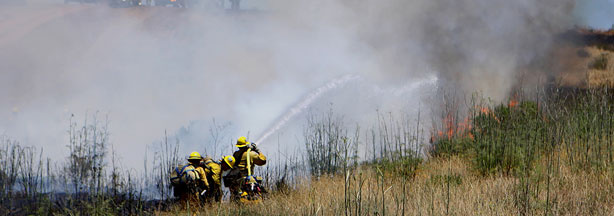 File photo: Firefighters from the Los Angeles Fire Department extinguish a fire during Camp Pendleton's 30th annual Fire School training exercise, June 9, 2010.