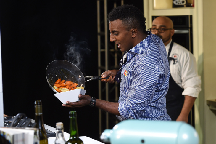 Chef Marcus Samuelsson gives a cooking demonstration at the Grand Tasting presented by ShopRite featuring KitchenAid® culinary demonstrations presented by MasterCard during the New York City Wine & Food Festival at Pier 94 on October 19, 2014 in New York City.  (Photo by Larry Busacca/Getty Images for NYCWFF)