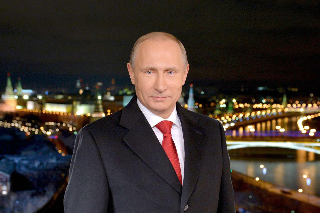 Russian President Vladimir Putin stands during a TV address to the nation on December 31, 2014 in Moscow.