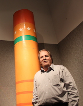 John Simones, co-CEO of The Jerde Partnership, stands with one of the colorful cardboard colonnades that were spread throughout all of southern California during the 1984 Olympics.