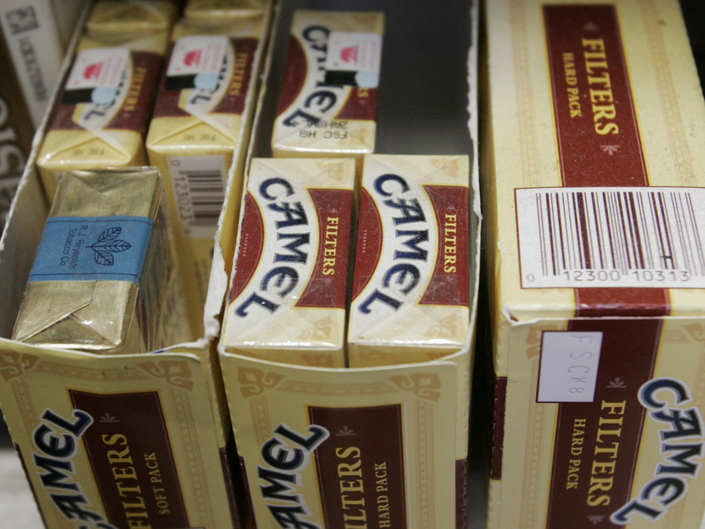 Camel cigarettes, an R.J. Reynolds brand, are seen on display at JJ&F Market in in Palo Alto, Calif. The company has vowed to appeal a $23 billion judgement.