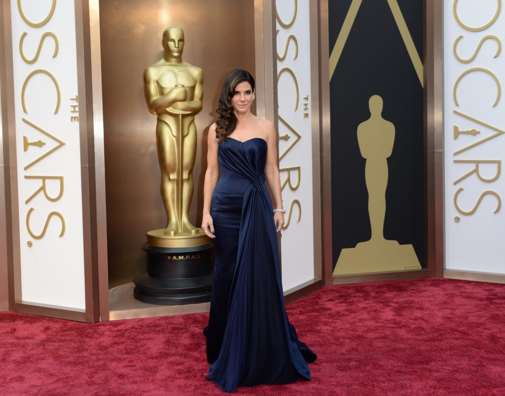 Nominee for Best Actress in 'Gravity' Sandra Bullock arrives on the red carpet for the 86th Academy Awards on March 2nd, 2014 in Hollywood.