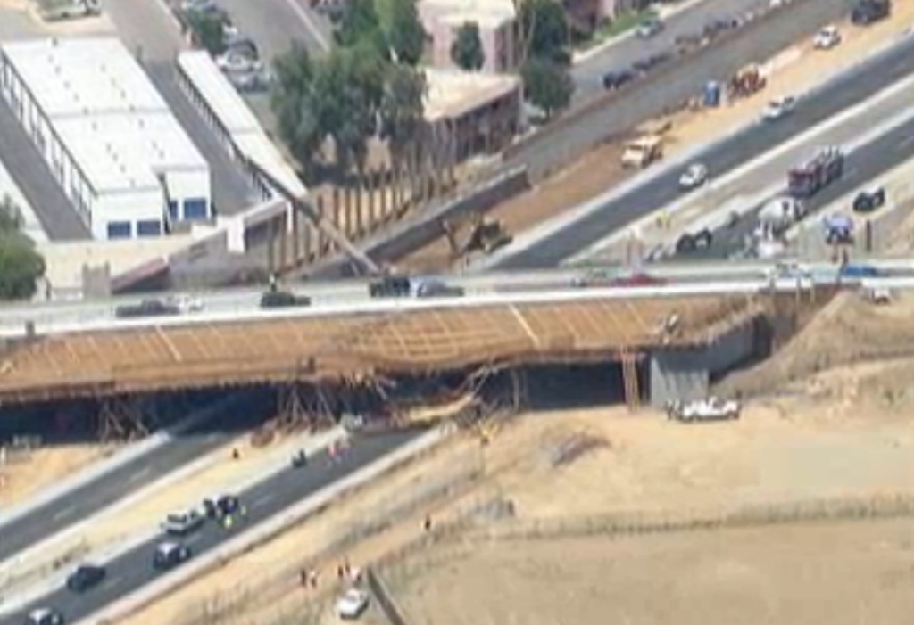 Footage from TV news helicopters showed the damage done to a bridge under construction after a big rig crash on Tuesday.