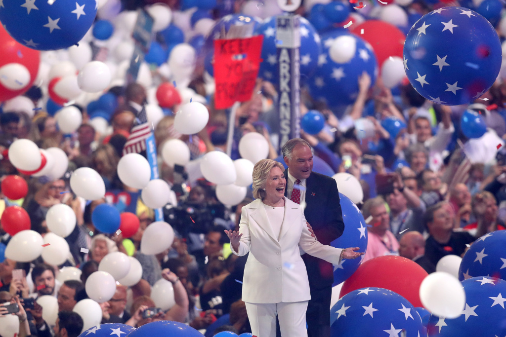 Democratic presidential candidate Hillary Clinton and US Vice President nominee Tim Kaine acknowledge the crowd at the end on the fourth day of the Democratic National Convention at the Wells Fargo Center, July 28, 2016 in Philadelphia, Pennsylvania.