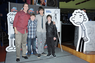 (L-R) Writer Jeff Kinney and actors Robert Capron, Devon Bostick and Zach Gordon attend the Planet Hollywood Times Square on March 16, 2011 in New York City.