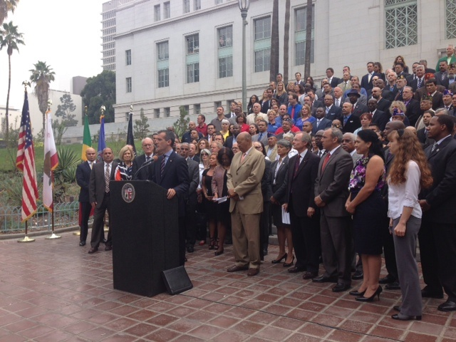 Mayor Eric Garcetti stands outside City Hall's First Street steps to announce an initiative to help place 10,000 veterans in jobs throughout Los Angeles County.