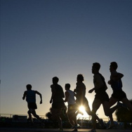 Apr 15, 2016; Norwalk, CA, USA; Silhouette of runners in the 1,500m in the 58th Mt. San Antonio College Relays at Cerritos College.