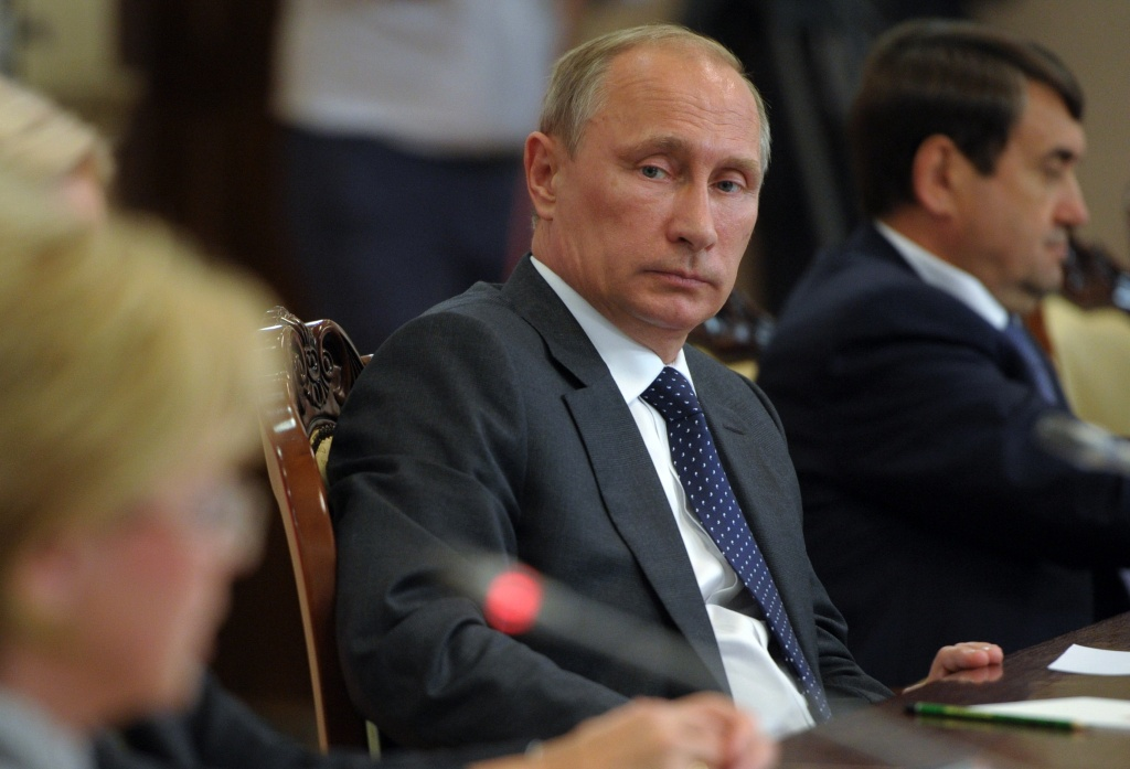 Russian President Vladimir Putin attends a meeting with local officials in Voronezh, Russia, Tuesday, Aug. 5, 2014. Putin says he has ordered the government to develop measures in response to Western sanctions.
