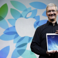 Apple CEO Tim Cook introduced the iPad Air in October 2013. The company says it is publicizing the names of suppliers that are still sourcing minerals from conflict regions.