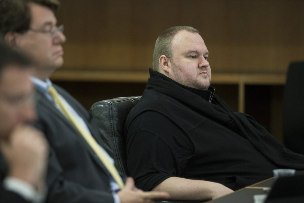 FILE - In this Sept. 21, 2015 file photo, Kim Dotcom sits in the Auckland District Court during an extradition hearing in Auckland, New Zealand. The much-delayed extradition hearing for Doctom and three others who owned or helped run the website Megaupload began in Auckland this week in a case that could have broader implications for Internet copyright rules.  (Jason Oxenham/New Zealand Herald via AP, File) AUSTRALIA OUT, NEW ZEALAND OUT