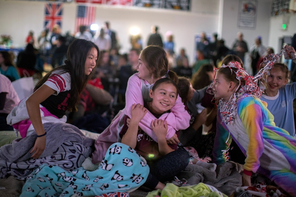 Students of Immaculate Heart High School and Middle School in Los Feliz watch a live broadcast of the wedding of Meghan Markle, who graduated from Immaculate Heart in 1999, to Britain's Prince Harry on May 19, 2018.