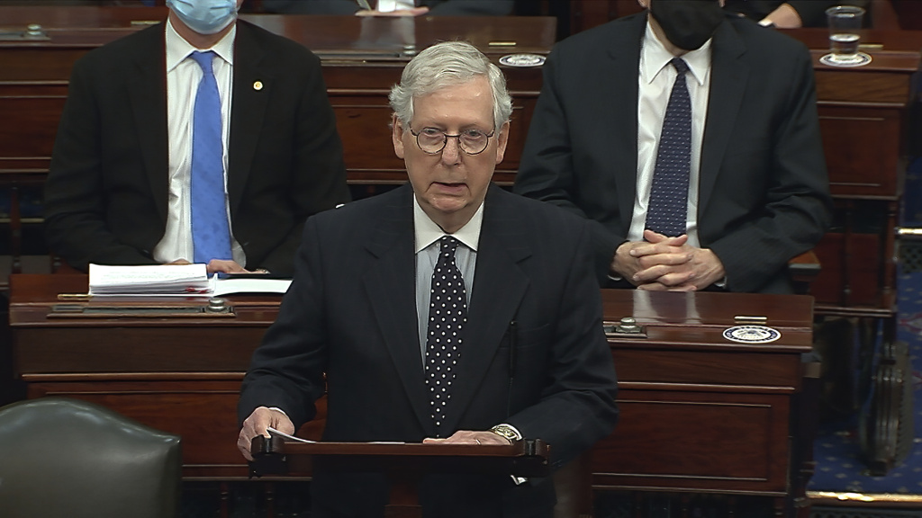 Senate Majority Leader Mitch McConnell of Kentucky speaks on the Senate floor as the Senate reconvened after a mob stormed into the U.S. Capitol on Wednesday.